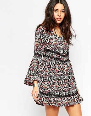 photo Bell Sleeve Dress by Band of Gypsies, color Navy Floral - Image 1
