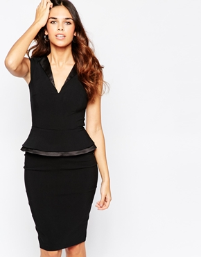 photo Grace V Neck Peplum Dress by Hybrid, color Black - Image 1