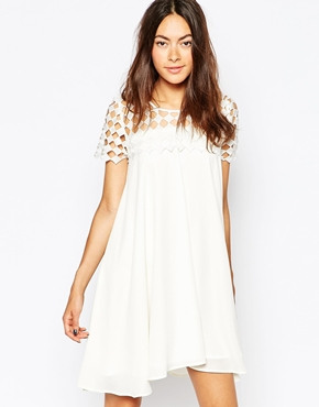 photo Ray Of Light Swing Dress with Cutwork Top by Jovonna Premier, color White - Image 1