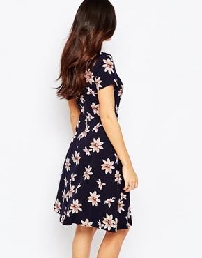photo Rosemary Tea Dress In Daisy Print by Poppy Lux, color Navy Multi - Image 2