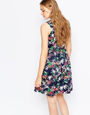 photo Saran Fit and Flare Dress In Tropical Floral Print by Poppy Lux, color Navy Multi - Image 2