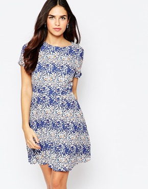 photo Sybil Skater Dress In Floral Print by Poppy Lux, color Blue Multi - Image 1