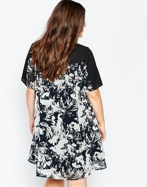 photo Swing Dress with Mesh Neckline In Mono Floral Print by So London Plus, color Black White - Image 2