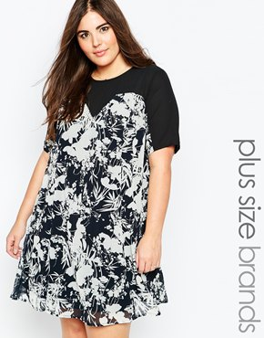 photo Swing Dress with Mesh Neckline In Mono Floral Print by So London Plus, color Black White - Image 1