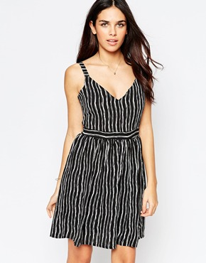 photo Skater Dress In Blurred Stripe Print by Style London, color Black - Image 1