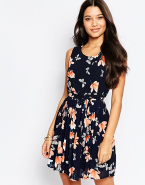 photo Skater Dress In Floral Print by Style London, color Navy - Image 1
