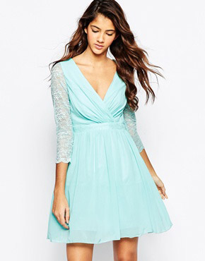 photo Cross Front Skater Dress with Lace Sleeves by Laced In Love, color Aqua - Image 1