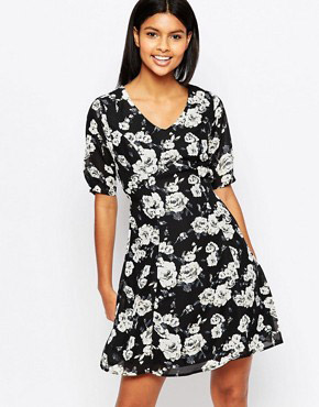 photo Thereasa Tea Dress In Rose Print by Poppy Lux, color Black - Image 1