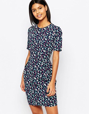 photo Vayda Tulip Dress In Floral Print by Poppy Lux, color Navy - Image 1