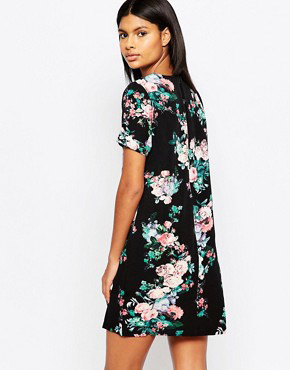 photo Zaria Tunic Dress In Floral Print by Poppy Lux, color Navy - Image 2
