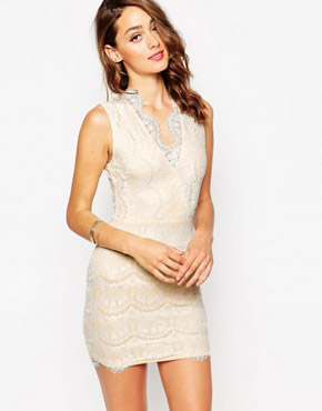 photo Myra Wrap Front Mini Dress in Scallop Lace by Sistaglam, color Nude White - Image 1