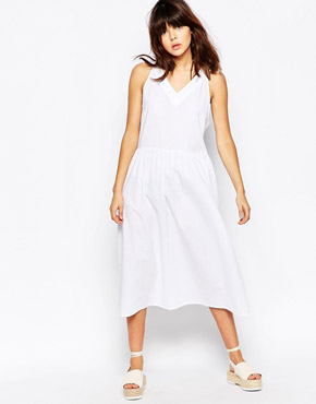 photo Ribbon Tie Back Midi Dress by The WhitePepper, color White - Image 1