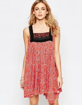 photo Embroidered Bib Front Mini Dress In Red by Hazel, color Red - Image 1
