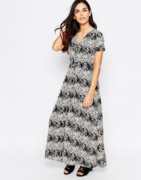 photo Vanessa Maxi Dress In Floral Print by Poppy Lux, color Black Multi - Image 1