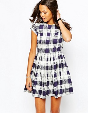 photo Organic Cotton Skater Dress in Brushed Check Print by People Tree, color Navy - Image 1