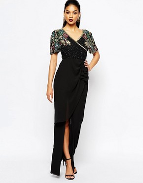 photo Ariann Embellished Maxi Dress with Frill Wrap Skirt by Virgos Lounge, color Black/Gold - Image 1