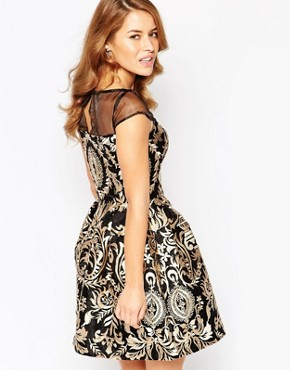 photo Brocade Prom Dress with Sheer Insert by Chi Chi London Petite, color Black/Gold - Image 2