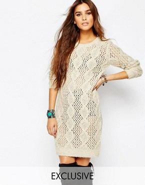 photo Cable Knitted Dress by Stitch & Pieces, color Cream - Image 1