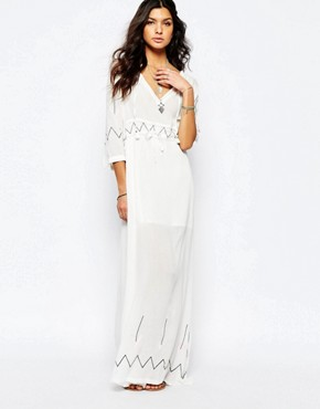 photo Miss Hart Longsleeve Maxi Dress in White by Stevie May, color White - Image 1