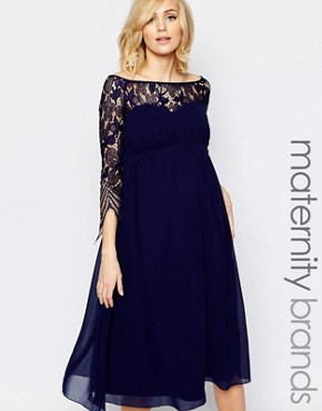 photo Midi Skater Dress with Lace Overlay by Little Mistress Maternity, color Navy - Image 1