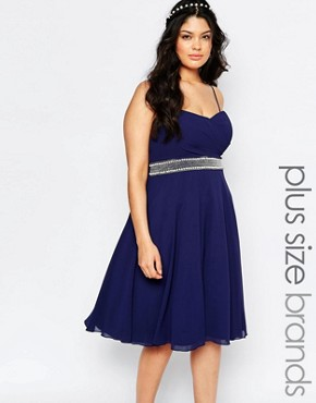 photo Chiffon Midi Prom Dress with Full Skirt and Embellished Waist by TFNC Plus, color Navy - Image 1