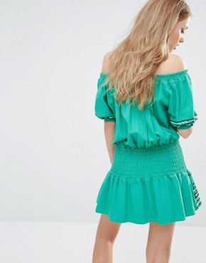 photo Butuan Off Shoulder Mini Dress in Green by Piper, color Kelly Green - Image 2