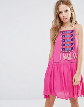 photo Varacruz Mini Dress with Tassel Bib by Piper, color Fuchsia - Image 1