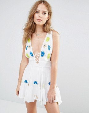 photo Papua Floral Embroidered Flippy Dress with Tie Front by Piper, color White - Image 1