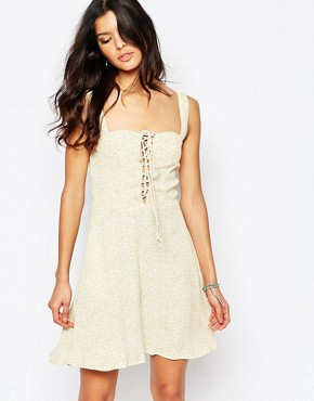 photo Leila Lace Up Mini Dress by Flynn Skye, color Yellow - Image 1