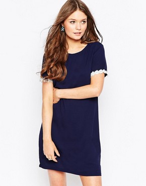 photo Valerie Tunic Dress with Crochet Trim by Poppy Lux, color Navy - Image 1