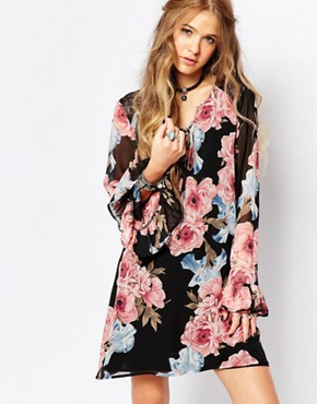 photo Festival Bell Sleeve Dress in Floral Print by Honey Punch, color Black Floral - Image 1