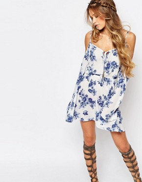 photo Boho Dress with Strappy Cold Shoulder in Floral Print by Honey Punch, color White - Image 1