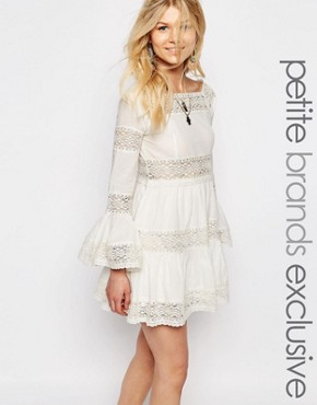 photo All Over Lace Bell Sleeve Panelled Skater Dress by White Cove Petite, color White - Image 1