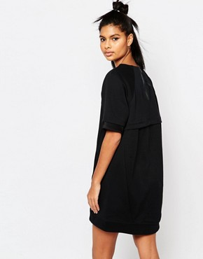 photo Luxury Fleece T-Shirt Dress by Nike, color Black - Image 2