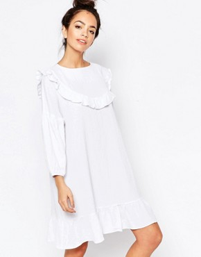 photo Bib Detail Ruffle Dress by The WhitePepper, color White - Image 1