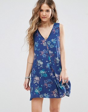 photo V Neck Swing Dress with Cut Out Back in Floral Print by Honey Punch, color Blue - Image 1