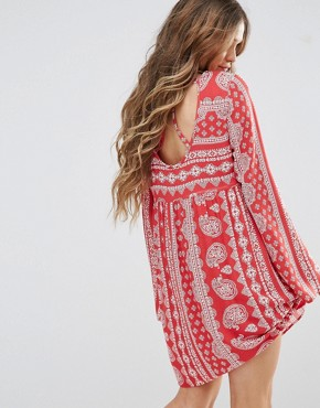 photo V Neck Swing Dress in Paisley Print with Tie Up Back by Honey Punch, color Red - Image 2