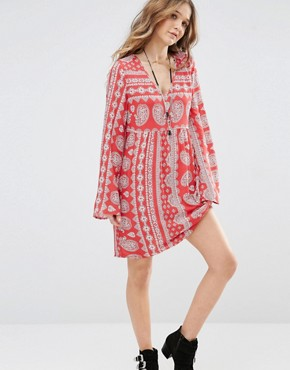 photo V Neck Swing Dress in Paisley Print with Tie Up Back by Honey Punch, color Red - Image 1