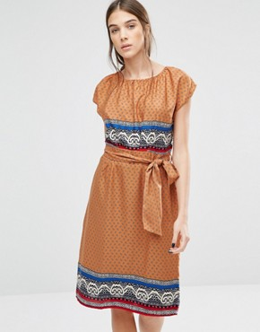 photo Elastic Fantastic Ditsy Print Dress by Trollied Dolly, color Orange - Image 1