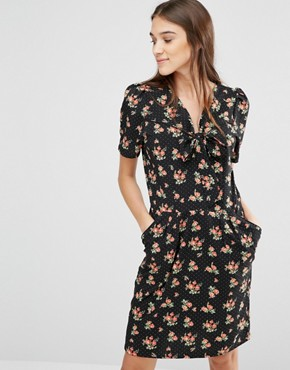 photo It'S Bowtime Floral Print Dress by Trollied Dolly, color Black - Image 1