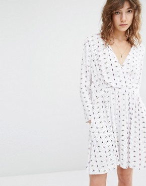 photo Caren Wrap Front Dress in Print by Suncoo, color White - Image 1