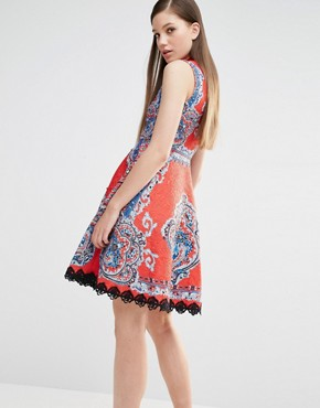 photo High Neck Skater Dress in Mutli Print with Stud Detail by Comino Couture, color Red Multi - Image 2
