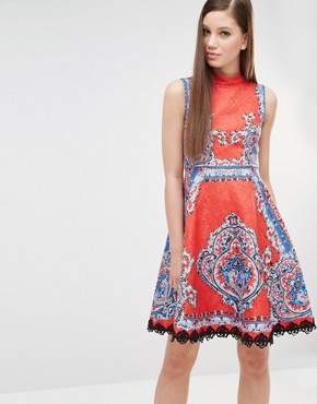 photo High Neck Skater Dress in Mutli Print with Stud Detail by Comino Couture, color Red Multi - Image 1