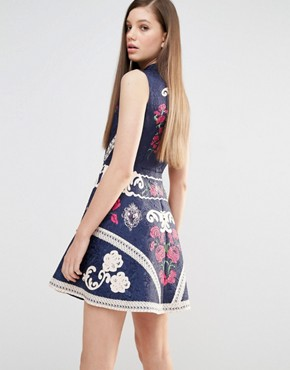 photo High Neck Skater Dress with Engineered print and embellishment by Comino Couture, color Navy - Image 2