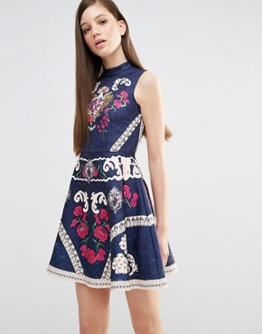 photo High Neck Skater Dress with Engineered print and embellishment by Comino Couture, color Navy - Image 1