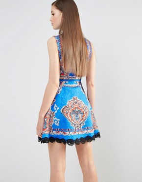 photo High Neck Skater Dress in Mutli Print with Stud Detail by Comino Couture, color Cobalt Blue - Image 2
