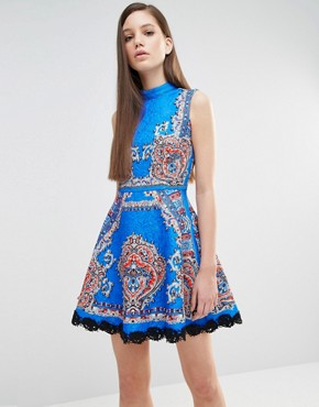photo High Neck Skater Dress in Mutli Print with Stud Detail by Comino Couture, color Cobalt Blue - Image 1