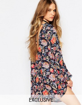photo Long Sleeve Tunic Dress with Tie Back Detail in Floral Print by Reclaimed Vintage, color Black - Image 1