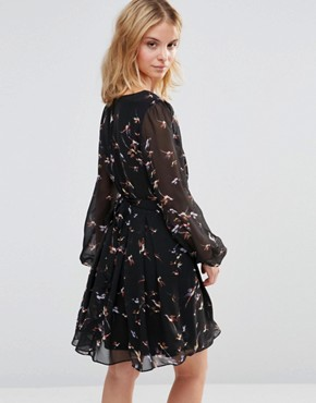 photo Wrap Front Dress in Bird Print by Style London, color Black - Image 2