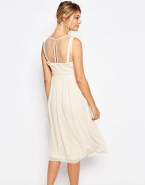photo Lace Overlay Sleeveless Skater Dress by Little Mistress Maternity, color Cream - Image 2
